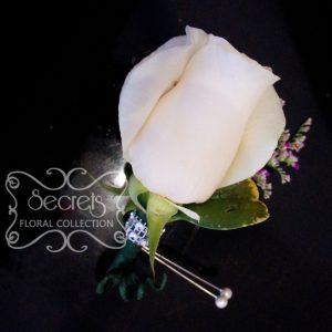 Fresh cream rose and purple lumonium boutonniere, embellished with crystallized bling ribbon (front-view) - Toronto Wedding Flowers Created by Secrets Floral Collection