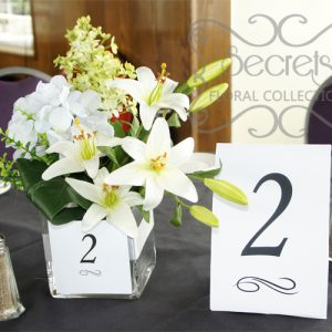 Artifcial White Lilies, White Hydrangea, and Pale Yellow Lillac Round Guest Table Centrepiece, with Table Number