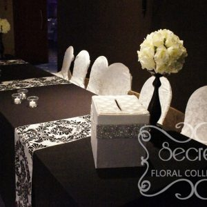 Ivory Rose Ball on Black Stand Arrangements on Receiving Table