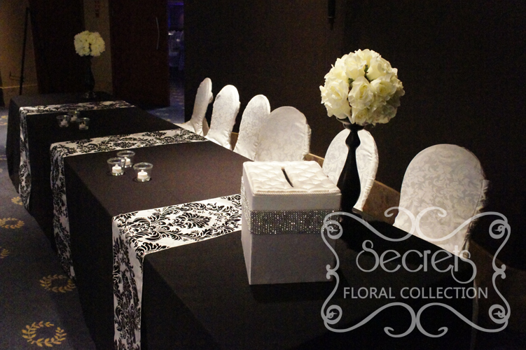 Wedding accessories archives secrets floral collection ivory rose ball on black stand arrangements on receiving table junglespirit Image collections