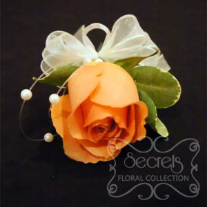 Fresh Coral Rose and Pittosporum Pin-On Corsage with Pearl Strands Accent for the Mothers (Top View)