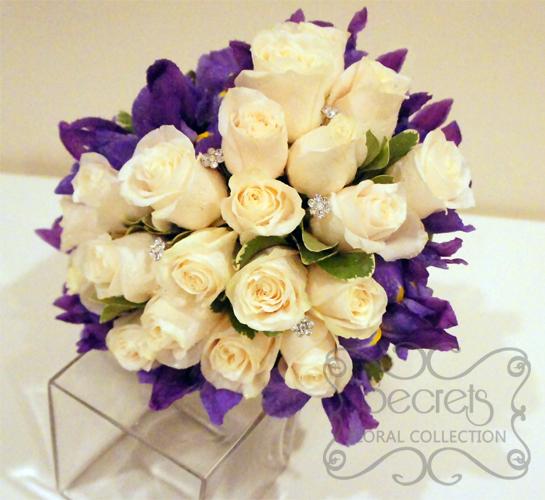 Fresh Cream Roses, Purple Iris, and Pittosporum Heart-Shaped Bridal ...