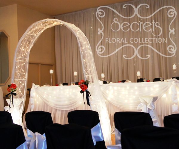 Wedding Arch Decorated With Tulle: Wedding Arch Is Decorated With White Tulle, Twinkle Lights