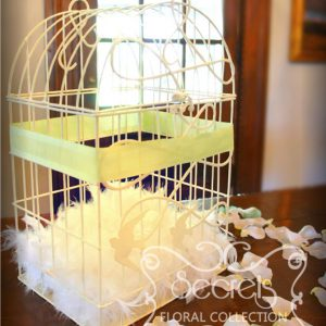 Close-up of our birdcage money box, perfect match for a vintage-inspired wedding
