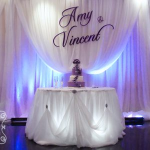 Large Purple Name Plate on Cream Voile Backdrop