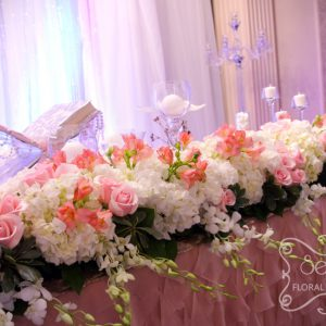 Long Head Table Floral Arrangement with Cream Hydrangea, Carnations, Dendrobium Orchids, Pink Roses, and Coral Alstromeria