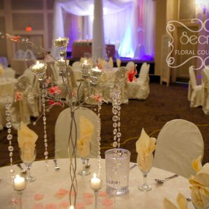 Guest Table Setup with Ivory Tablecloth and Chair Covers