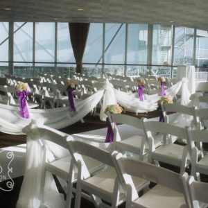 An indoor wedding ceremony in the Lakeview Room in Atlantis Pavillions