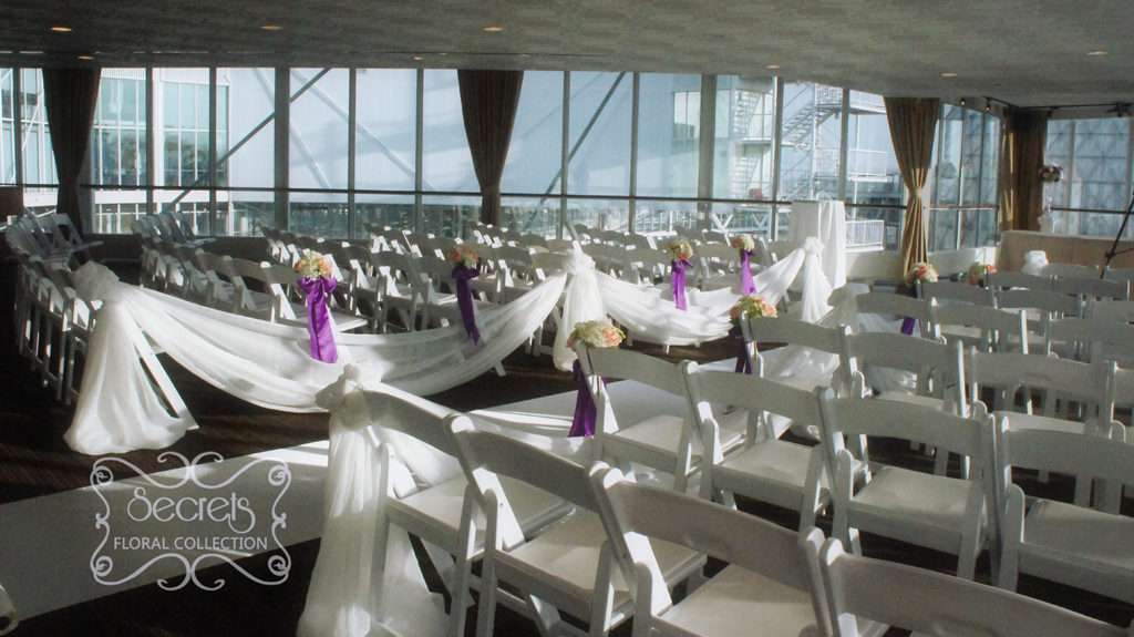 A Purple Wedding Ceremony And Reception Decoration With A Touch Of