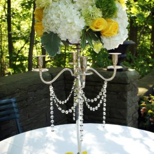 Elevated cream, green, and yellow centrepieces were used in the ceremony as well
