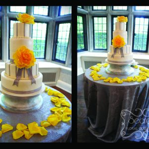Cake table is also dressed in silver damask tablecloth. Love how the yellow petals compliments the cake