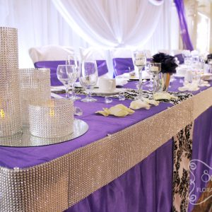 Close-up of the purple, damask, and crystallized head table - Toronto Wedding Decor Created by Secrets Floral Collection