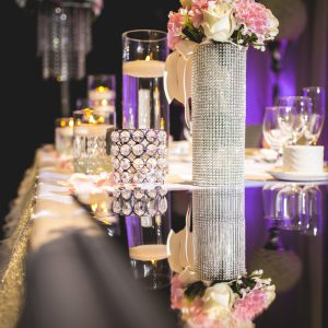 Wedding head table is also filled with light pink and cream flowers from the bridal party bouquets. Photo by Andes Lo Photography - Toronto Wedding Decor Created by Secrets Floral Collection