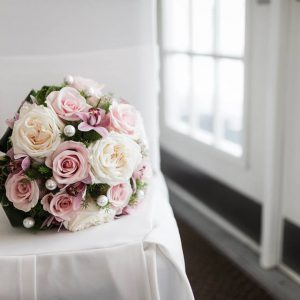 A winter bridal bouquet, with cream garden roses (white o'hara), blush pink roses, and light pink cymbidium orchids, and embellished with large oversized pearls - Toronto Wedding Flowers by Secrets Floral Collection