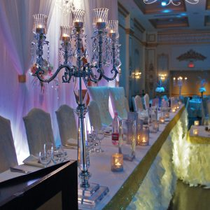 Head table was filled with crystal candelabras and candle holders to add bling and sparkles - Toronto Wedding Decor Created by Secrets Floral Collection