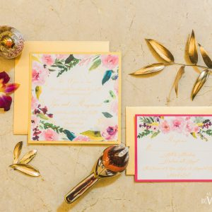Detail shot of gold foliage, floral themed wedding invitations and decorate gold birds. Cinderella themed style shoot located at the Victorian Convention centre, Missisauga.
