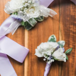 Cream spray roses and white baby's breath boutonniere and corsage, with lavender purple ribbon. Toronto wedding flowers by Secrets Floral.