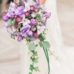 Teardrop cascade bridal bouquet, with purple tulips, lisianthus, freesia, astrantia, alstromeria, ivory hypericum, eucalyptus, and trailing greenery. Toronto wedding flowers at Fontana Primavera by Secrets Floral.