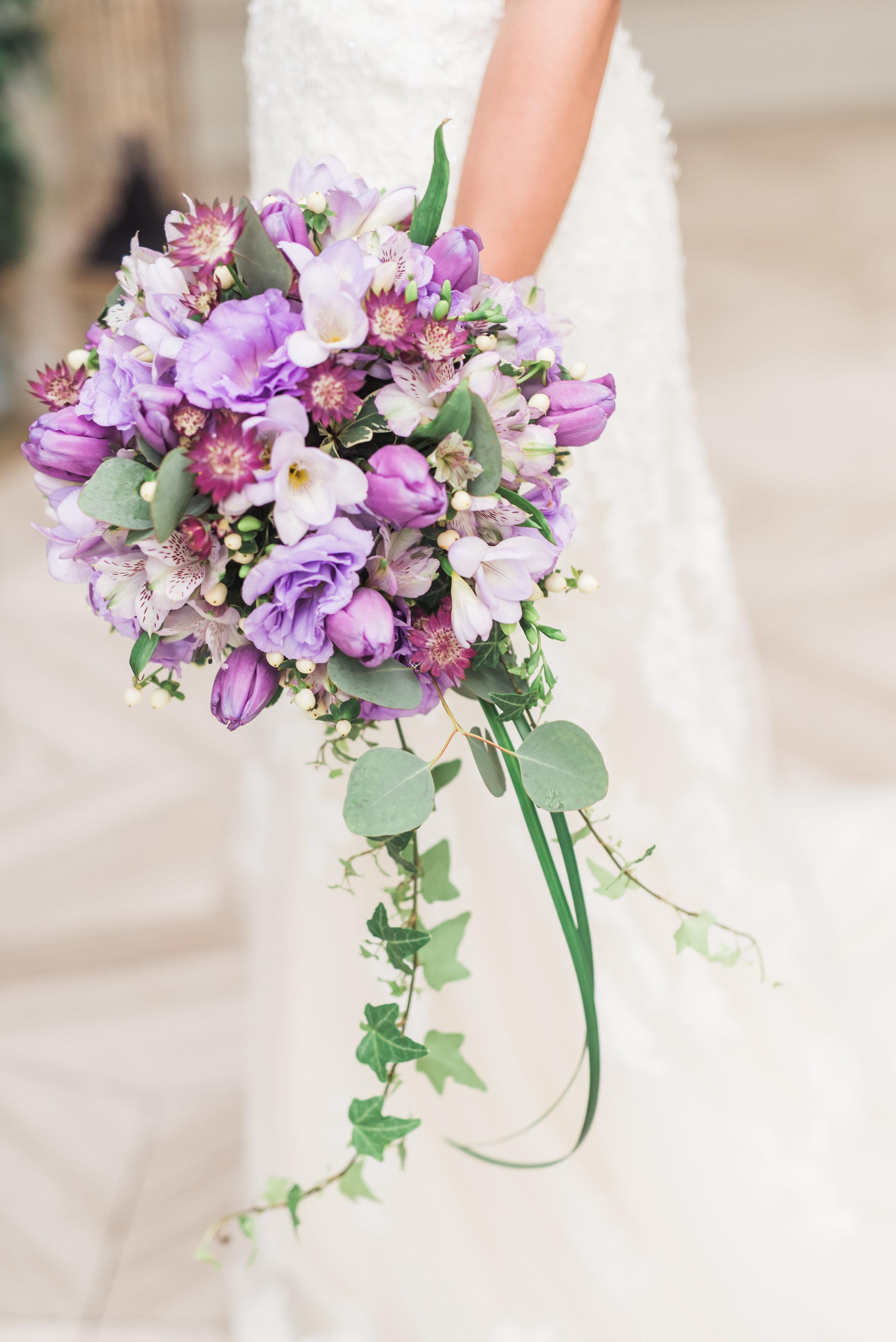 Flowers archives secrets floral collection teardrop cascade bridal bouquet with purple tulips lisianthus freesia astrantia alstromeria izmirmasajfo