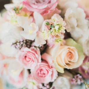 Fresh cream and blush pink bridal bouquet, with roses, lisianthus, cymbidium orchids, stock flowers, and dusty miller. Toronto wedding flowers by Secrets Floral.