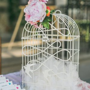 Rustic birdcage money box, embellished with pink peony flower. Toronto wedding decor at Graydon Hall by Secrets Floral.