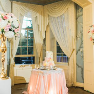 Wedding cake table in blush pink and gold. Toronto wedding decor at Graydon Hall by Secrets Floral.