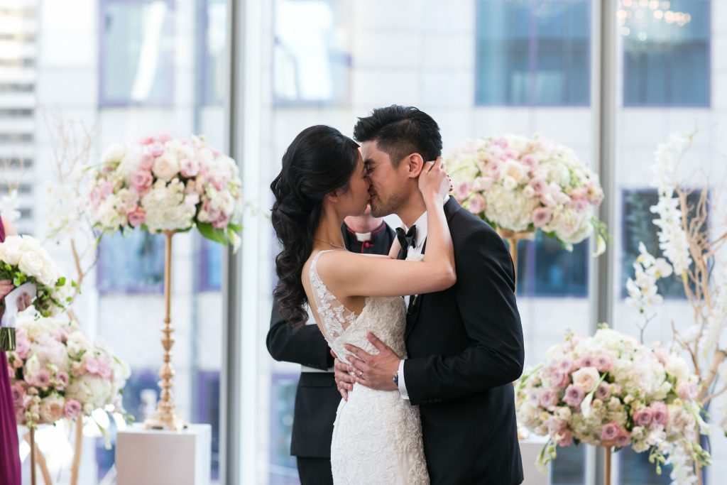 Wedding ceremony at Shangri-La Hotel, in the Museum Room. Wedding flowers and decor by Secrets Floral.