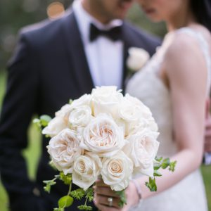 Bridal bouquet with white and cream garden roses. Flower by Secrets Floral.
