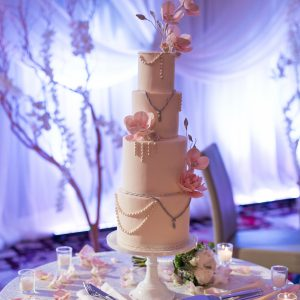 Gorgeous wedding cake at the Shangri-La Hotel. Flower and decor by Secrets Floral.