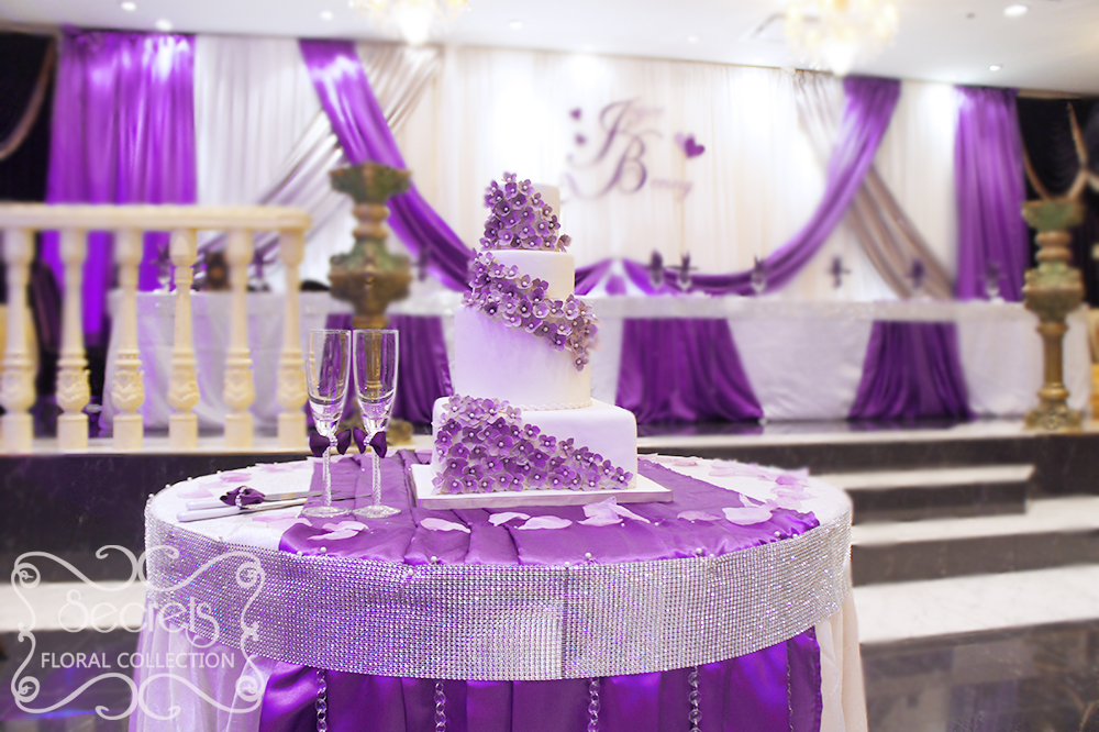 Cake Table Decorated With White Crinkled Linen And Purple