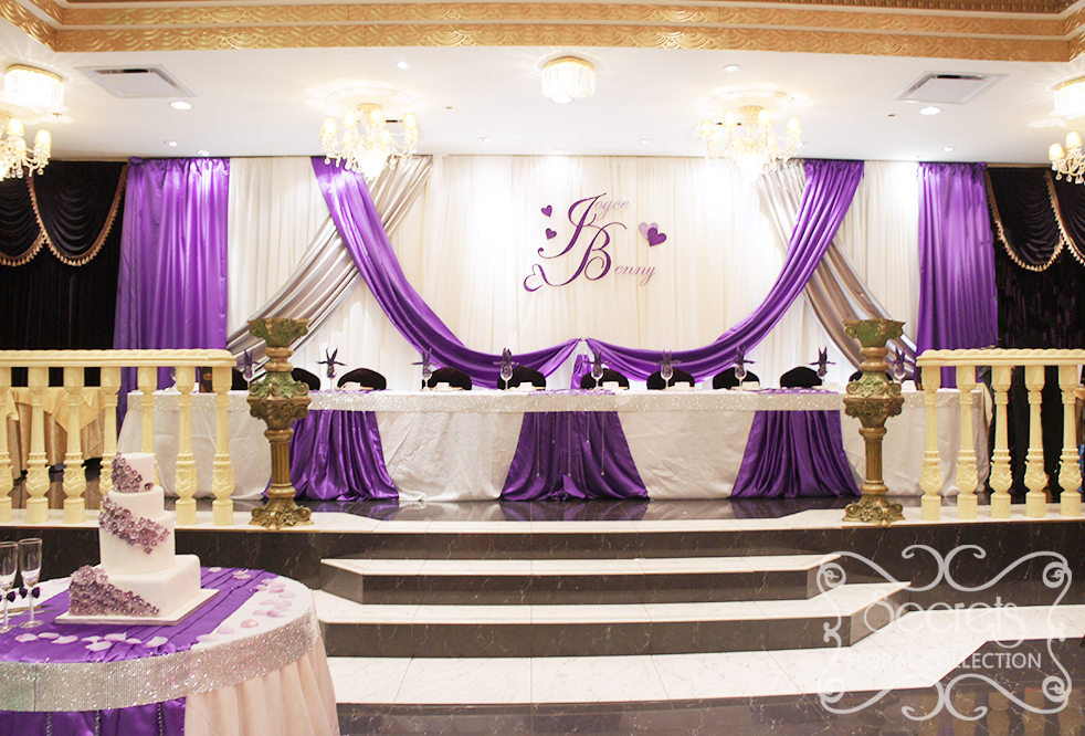 An Extra Long Backdrop With Royal Purple And Silver Satin Accents